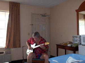 Robby working on songs in a hotel room circa 2005